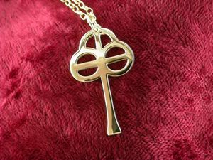 A picture of '18ct Gold St Caron Cross Pendant'
