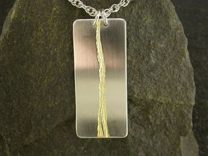 A picture of 'Silver and Gold Afon Ystwyth Pendant'