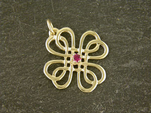 A picture of '9ct Rhiannon Welsh Gold Ruby Rose Pendant'
