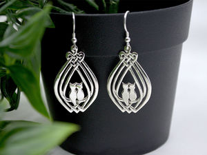 A picture of 'Silver Cuddle Cats Earrings'