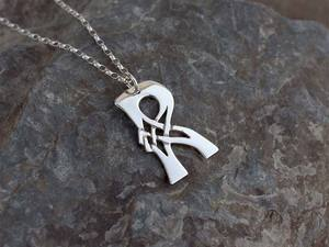 A picture of 'Silver Pendant - Initial R'