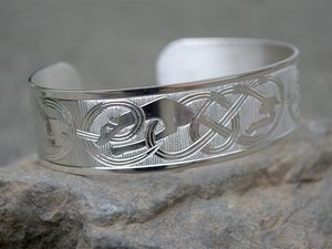 A picture of 'Silver Hounds of Annwn Bangle '