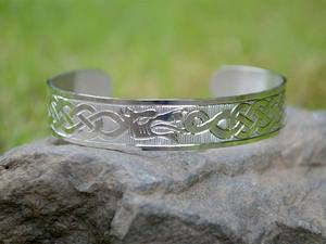 A picture of 'Silver Merlin's Dragons Bangle'