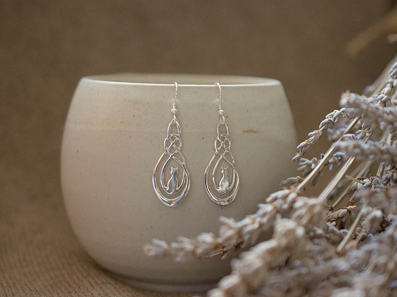 A picture of 'Silver Lost Cat Earrings''