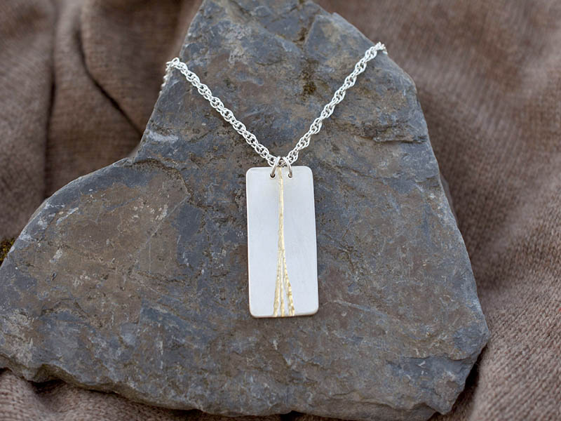 A picture of 'Silver and Gold Afon Ystwyth Pendant''