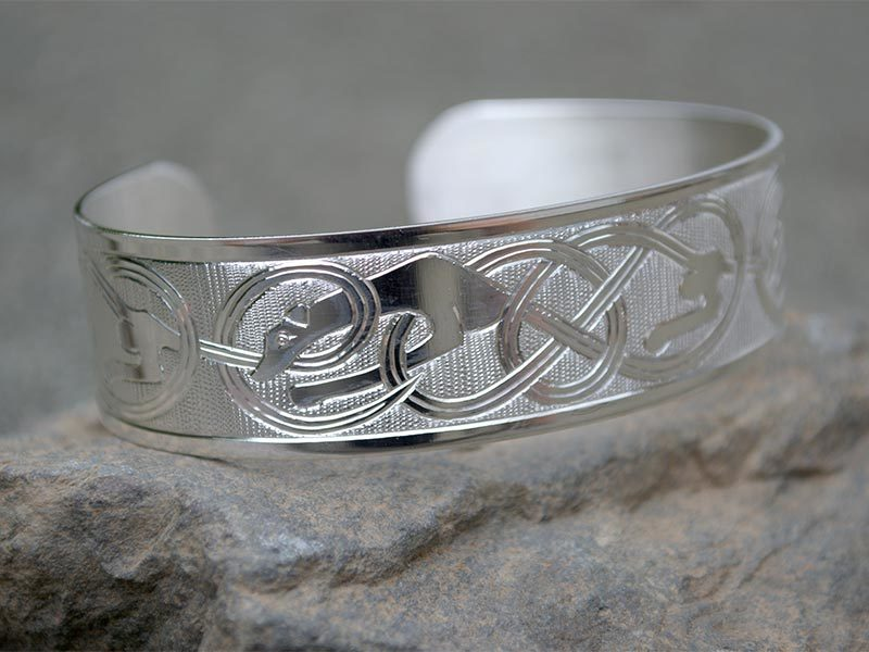 A picture of 'Silver Hounds of Annwn Bangle ''
